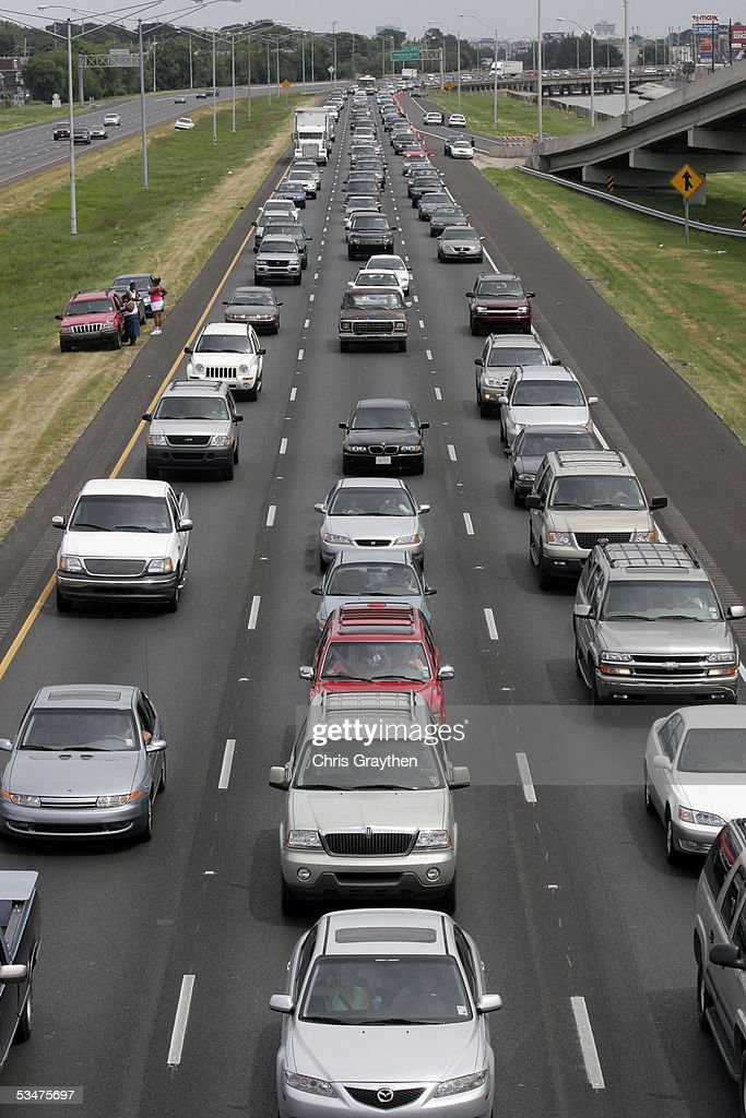 Motorists drive on Interstate 10 west as they evacuate ahead of Hurricane Katrina August 28, 2005 in New Orleans, Louisiana. A 'contraflow' program was set up by state police that allowed all interstate traffic lanes to head either west or north away from the storm.