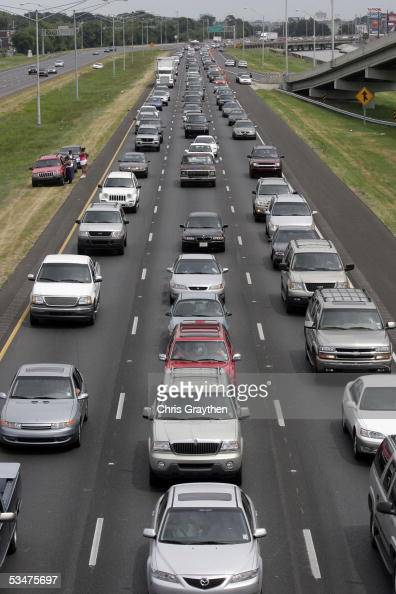 Motorists drive on Interstate 10 west as they evacuate ahead of Hurricane Katrina August 28 2005 in New Orleans Louisiana A 'contraflow' program was...