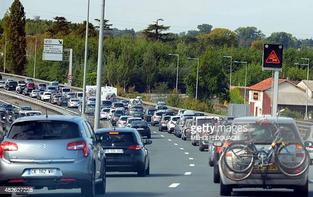 Motorists drive past a traffic advisory panel during heavy traffic on the A10 autoroute in Libourne on August 1 2015 This weekend is expected to be...