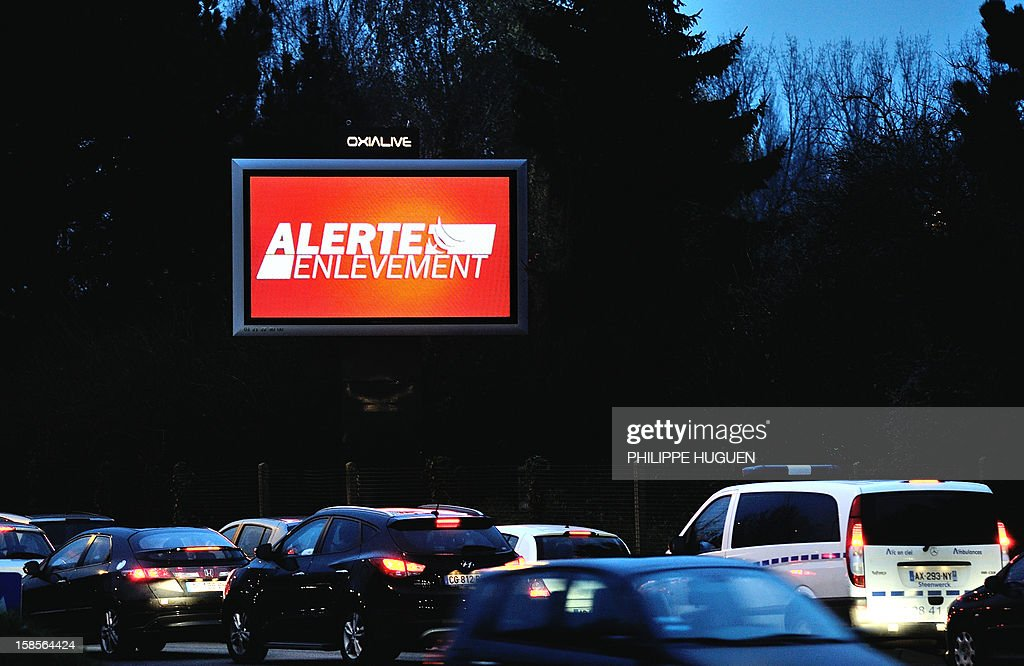 Motorists drive past an information board announcing the 'alerte enlevement' (kidnapping alert) plan following the abduction of a new born baby at Nancy's university hospital on December 19, 2012 in Lille.