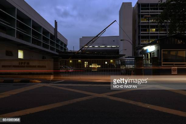 Motorists drive past the forensics wing of the Hospital Kuala Lumpur where the body of Kim JongNam is being held in Kuala Lumpur on March 19 2017...