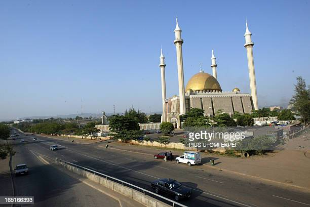 Motorists drive past the national central mosque in Abuja 27 November 2006 Nigeria's federal capital which is poised to host an OPEC meeting in...