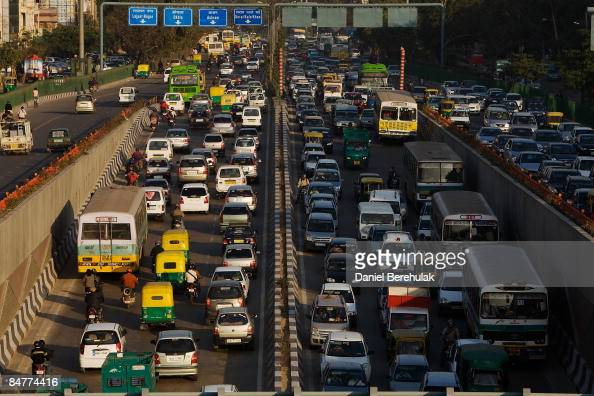 Motorists drive through rush hour traffic on February 13 2009 in New Delhi India As parts of the capital's metro have opened construction has gone...