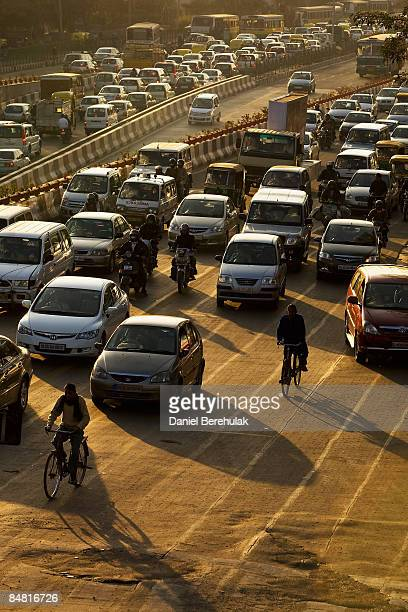 Motorists drive through rush hour traffic on February 16 2009 in Delhi India Parts of the capital's metro system have gone into their second phase to...