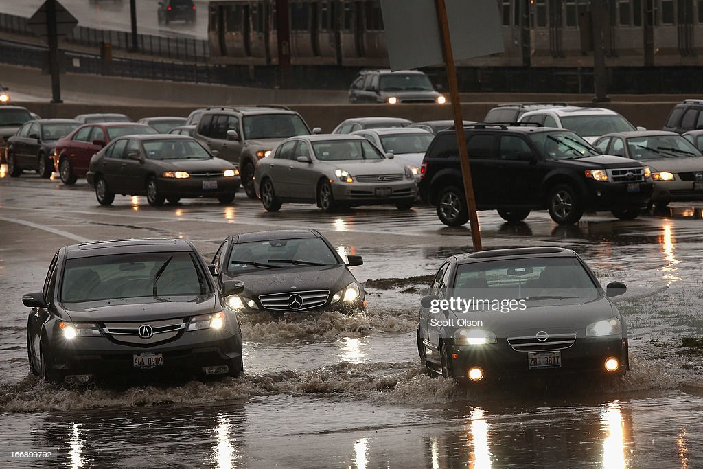 Motorists drive through water on a flooded exit ramp from the Kennedy Expressway on April 18, 2013 in Chicago, Illinois. Thunderstorms dumped up to 5 inches of rain on parts of the Chicago area overnight, closing sections the Edens, Eisenhower and Kennedy expressways, which lead to and from downtown, during the morning rush.
