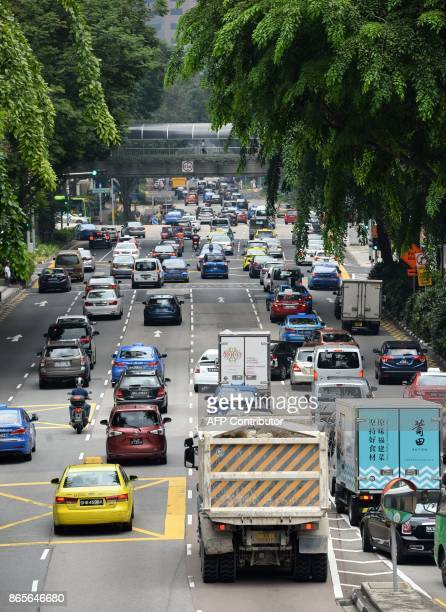 Motorists enter the financial district area in Singapore on October 24 2017 Singapore one of the most expensive places in the world to buy a vehicle...