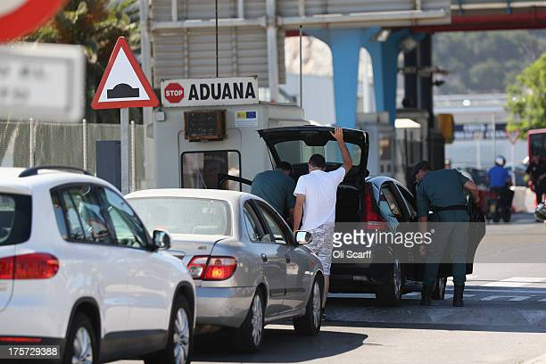 Motorists have their vehicles searched by police as they queue at the border to enter Gibraltar on August 7 2013 in La Linea de la Concepcion Spain...