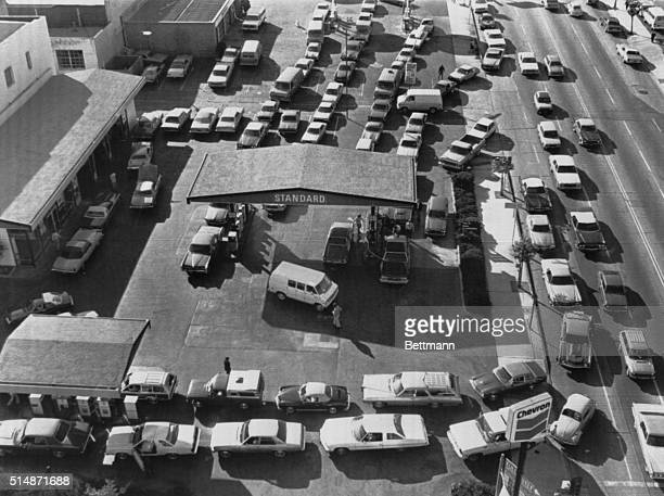 Motorists line up for gas on the first day of gas rationing imposed on nine California counties following the revolution in Iran that caused a...