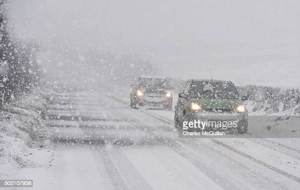 Motorists make their way through heavy snow across Black mountain on January 15 2016 in Belfast Northern Ireland The first heavy snowfall of the year...