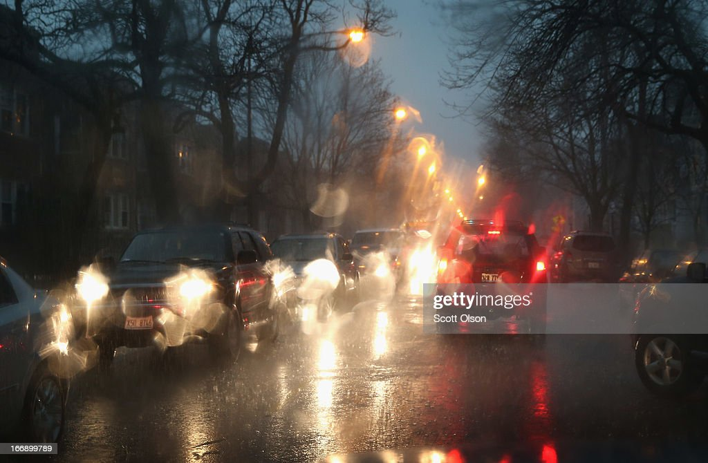 Motorists navigate surface streets during a heavy rainfall on April 18, 2013 in Chicago, Illinois. Thunderstorms dumped up to 5 inches of rain on parts of the Chicago area overnight, closing sections the Edens, Eisenhower and Kennedy expressways, which lead to and from downtown, during the morning rush.