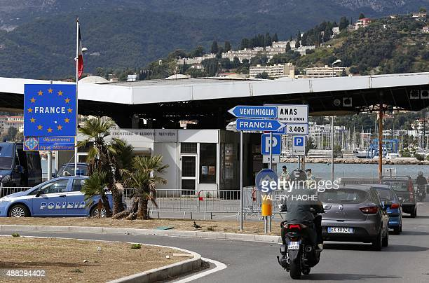 Motorists queue as French police carry out inspections on the ItalianFrench border where a group of migrants has been camping since being denied...