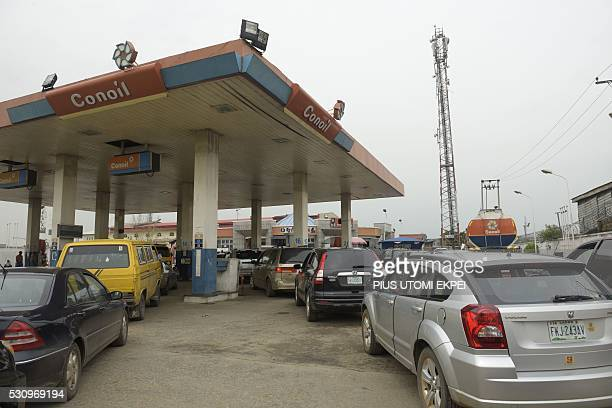 Motorists queue to buy fuel at a filling station in Lagos on May 12 2016 Nigeria hiked the price of petrol on May 11 2016 after months of fuel...