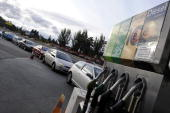 Motorists queue up to get fuel at a fuel station in Madrid during the first day of a nationwide haulers strike on June 9 2008 in Madrid Spain Spanish...
