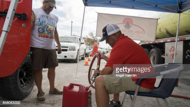 Motorists receive free gasoline from the Fuel Relief Fund group in Big Pine Key on September 16 2017 in Marathon Florida Many places in the Keys...