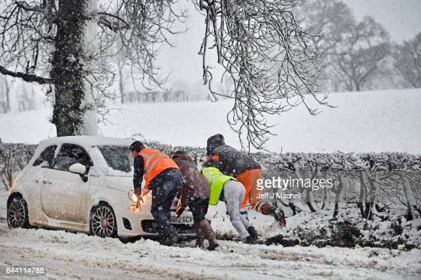 Motorists struggle through the snow at Balfron Station on February 23 2017 in Balfron Scotland Travel disruption is affecting many parts of Scotland...