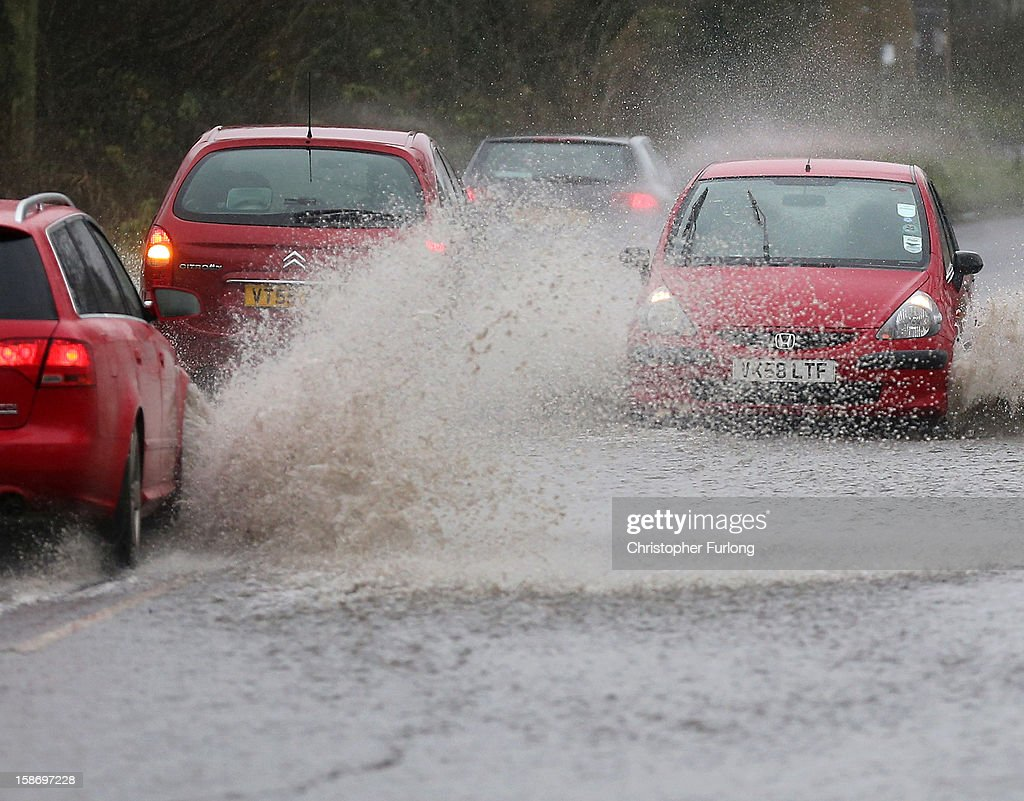Motorists tackle a flash flood near Tewkesbury at the confluence of the River Severn and the River Avon on December 24, 2012 in Tewkesbury, England. Forecasters have predicted more rain to sweep across the country causing flash flooding over the coming days. The South West of England has been badly affected causing major disruption to the rail network delaying journeys for people making their way home for Christmas.
