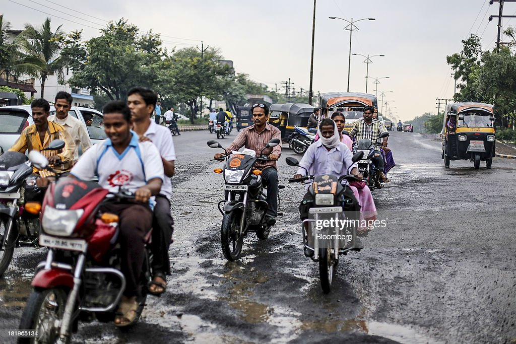 Motorists travel along a road beside the Wockhardt Ltd. manufacturing facility in the Chikalthana industrial area in Aurangabad, India, on Monday, Sept. 16, 2013. Wockhardt currently controls about 26 percent of the U.S. market for metoprolol, a generic version of the heart pill sold by London-based AstraZeneca Plc under the brand name Toprol-XL, according to Needham & Co. Metoprolol alone makes up about 14 percent of the company's 56 billion rupees in annual revenue. Photographer: Dhiraj Singh/Bloomberg via Getty Images