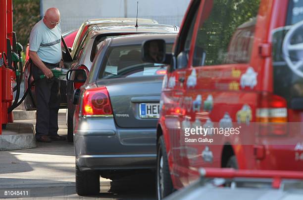Motorists wait in line to buy gasoline at a gas station with lower prices on May 10 2008 in Berlin Germany Gasoline prices in Germany have been...