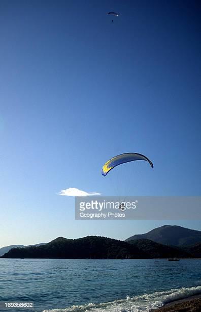 Motorized paraglider over the sea Olu Deniz Fethiye Turkey