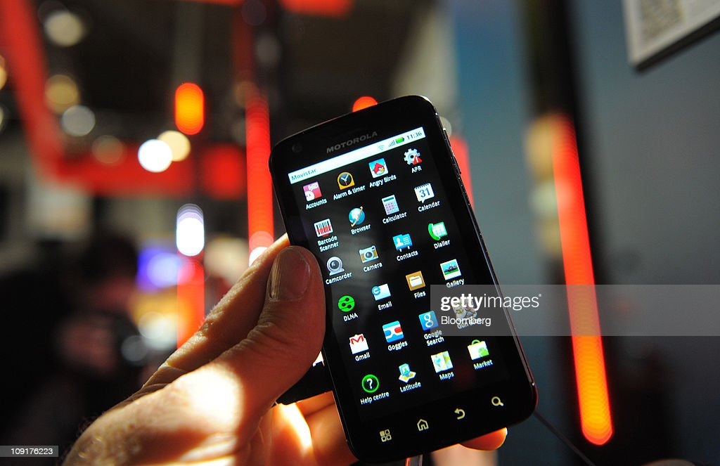 A Motorola Mobility Holdings Inc. Atrix mobile mobile handset is arranged for a photograph at the Mobile World Congress in Barcelona, Spain, on Wednesday, Feb. 16, 2011. Motorola Mobility Holdings Inc. introduced a tablet computer called Xoom last month that runs on Android. Photographer: Denis Doyle/Bloomberg via Getty Images