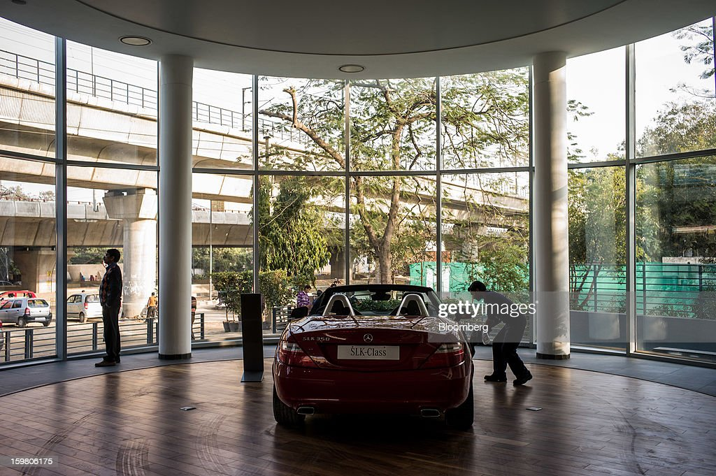 Motors Ltd. employee cleans a Daimler AG Mercedes-Benz SLK-350 vehicle as it sits on display inside the company's newly opened Mercedes-Benz India flagship dealership in New Delhi, India, on Saturday, Jan. 19, 2013. The Indian Finance Ministry projects Asia's third-largest economy will expand as little as 5.7 percent in the 12 months to March 31, which would be the weakest pace in a decade. Photographer: Sanjit Das/Bloomberg via Getty Images