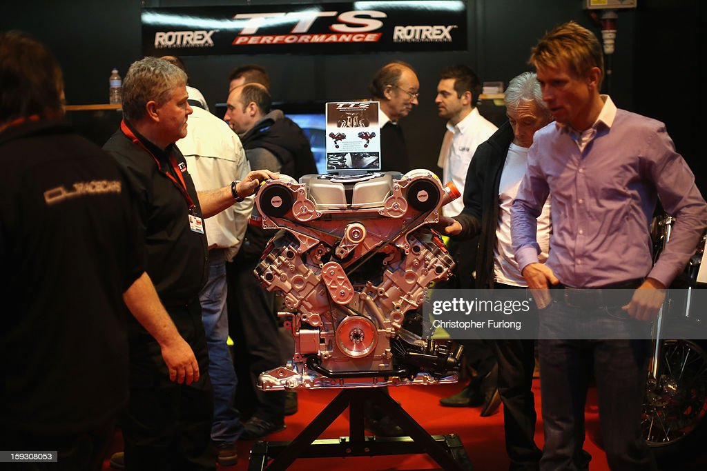 Motorsport fans peruse a high performance engine at the Autosport International Exhibition at the National Exhibition Centre on January 11, 2013 in Birmingham, England. The Autosport International is in it's 23rd year and features every kind of motor racing from Karting up to Formula 1. Speed fans are able to see the latest advances in technology as well take part in racing experiences in the indoor track and view classic racing cars available for sale in the auction room.