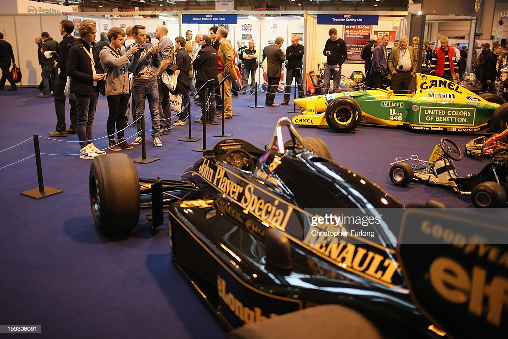 Motorsport fans view some of the racing cars on display at the Autosport International Exhibition at the National Exhibition Centre on January 11, 2013 in Birmingham, England. The Autosport International is in it's 23rd year and features every kind of motor racing from Karting up to Formula 1. Speed fans are able to see the latest advances in technology as well take part in racing experiences in the indoor track and view classic racing cars available for sale in the auction room.