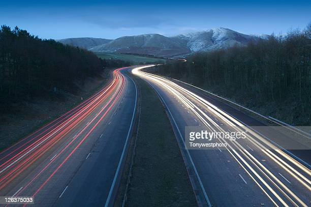 M6 motorway and Howgill fells at night