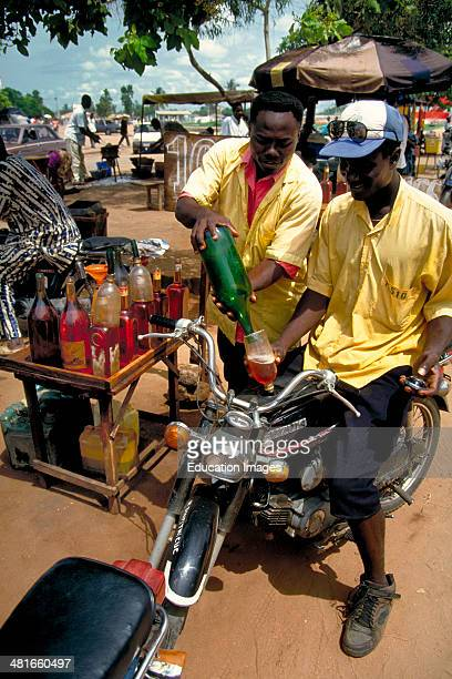 A mototaxi filling station in Cotonou Benin These motorcycle taxis are the principal means of public transport in Cotonou Benin West Africa