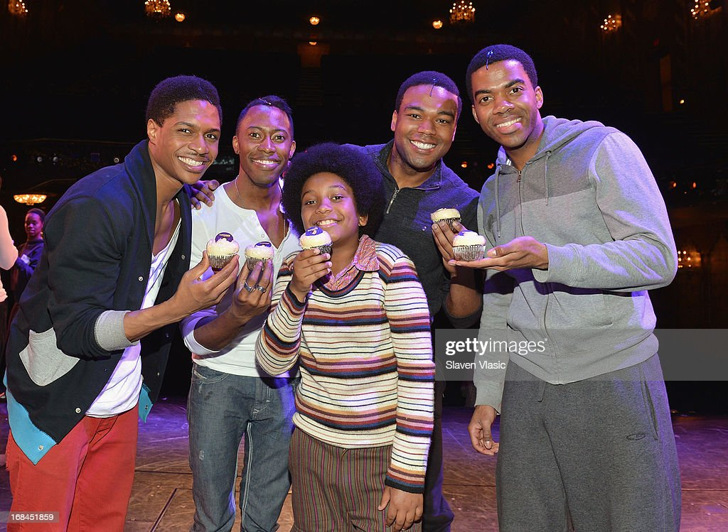 'Motown: The Musical' cast members Ephraim Sykes, Eric LaJuan Summers, Darius Kaleb, Grasan Kingsberry and Julius Thomas III unveil Magnolia Bakery's 'Motown' Cupcake at Lunt-Fontanne Theatre on May 9, 2013 in New York City.