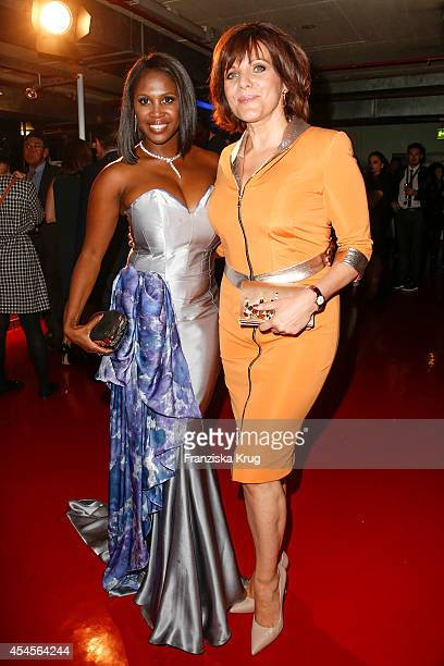 Motsi Mabuse and Birgit Schrowange attend the Blurry Garden Couture Collection Presentation in a nuclear bunker on September 03 2014 in Berlin Germany