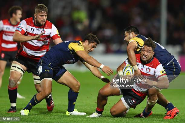 Motu Mati'u of Gloucester is tackled by Alafoti Faosiliva and Jackson Willison of Worcester Warriors during the Aviva Premiership match between...