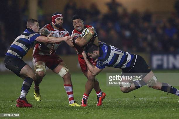 Motu Matu'u of Gloucester is tackled by Elliott Stooke of Bath as Chris Cook supports during the Anglo Welsh Cup match between Bath Rugby and...