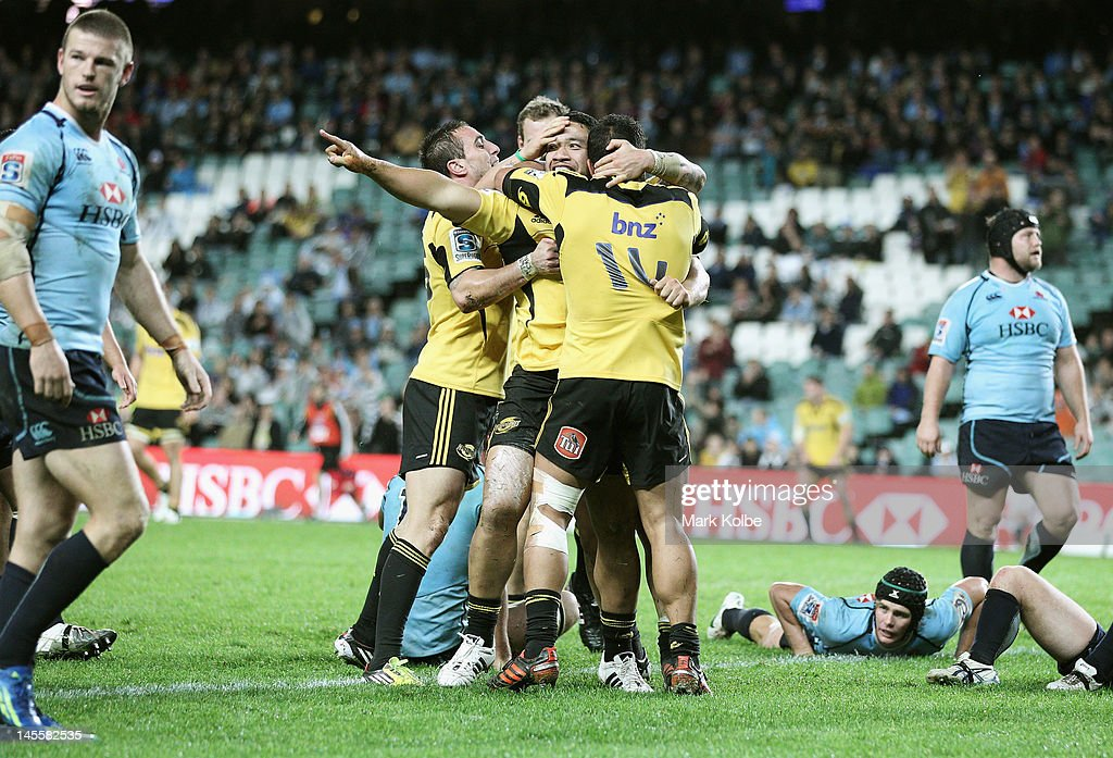 Motu Matu'u of the Hurricanes celebrates after scoring try during the round 15 Super Rugby match between the Waratahs and the Hurricanes at Allianz Stadium on June 2, 2012 in Sydney, Australia.