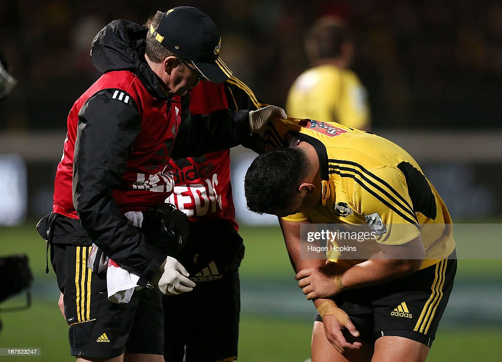 Motu Matu'u of the Hurricanes is helped by a medic after receiving an arm injury during the round 11 Super Rugby match between the Hurricanes and the Stormers at FMG Stadium on April 26, 2013 in Palmerston North, New Zealand.