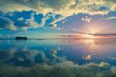 Motu reflections on the lagoon at Hauru Point