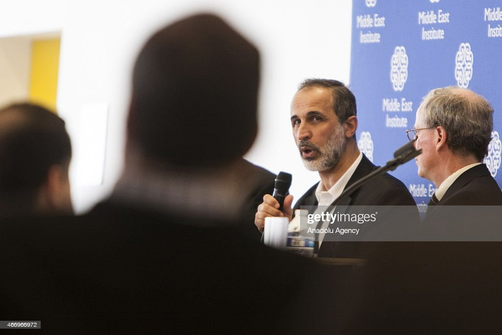 Mouaz Al-Khatib (R 2), president of the Syrian National Council, speaks during an event co-hosted by the Center for the Study of Islam and Democracy in Washington, USA on March 19, 2015.