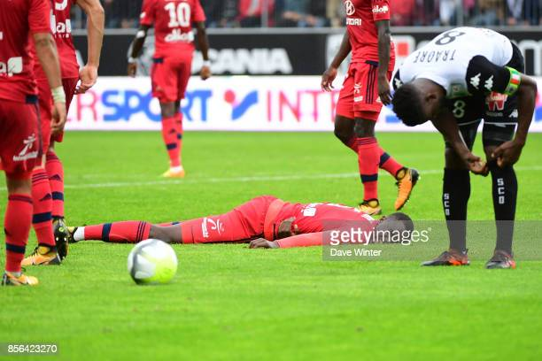 Mouctar Diakhaby of Lyon goes down injured during the Ligue 1 match between Angers SCO and Olympique Lyonnais at Stade Raymond Kopa on October 1 2017...