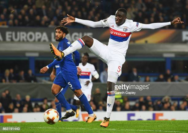 Mouctar Diakhaby of Lyon stretches for the ball ahead of Ashley Williams of Everton during the UEFA Europa League Group E match between Everton FC...