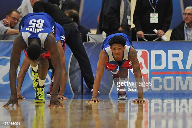 Mouhammadou Jaiteh and Cameron Payne complete a stretching drill during the 2015 NBA Draft Combine on May 14 2015 at Quest Multiplex in Chicago...