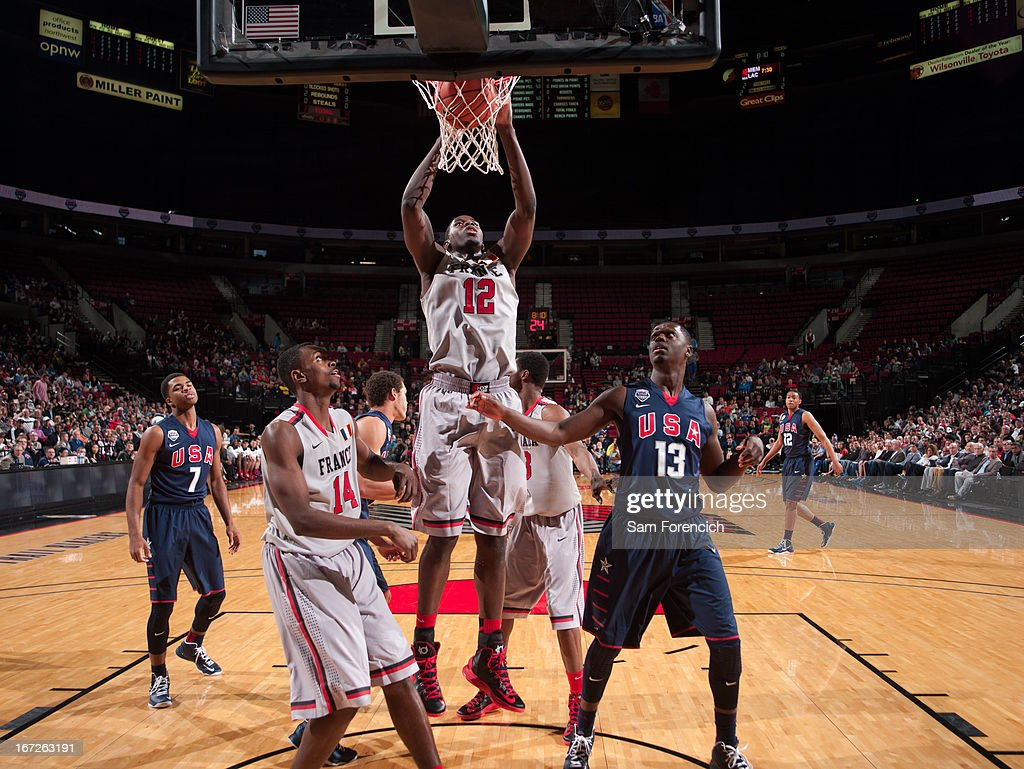 Mouhammadou Jaiteh #12 of the World Select Team dunks against Julius Randle #13 of the USA Junior Select Team during the 2013 Nike Hoop Summit game on April 20, 2013 at the Rose Garden Arena in Portland, Oregon.