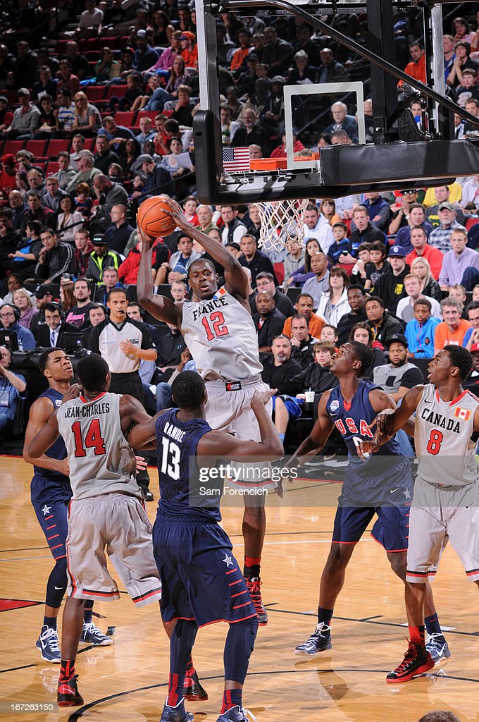 Mouhammadou Jaiteh #12 of the World Select Team rebounds against the USA Junior Select Team during the 2013 Nike Hoop Summit game on April 20, 2013 at the Rose Garden Arena in Portland, Oregon.