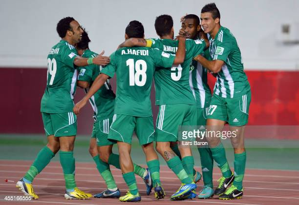 Mouhssine Iajour of Casablanca celebrates after scoring his teams first goal during the FIFA Club World Cup Playoff for Quarter Final match between...