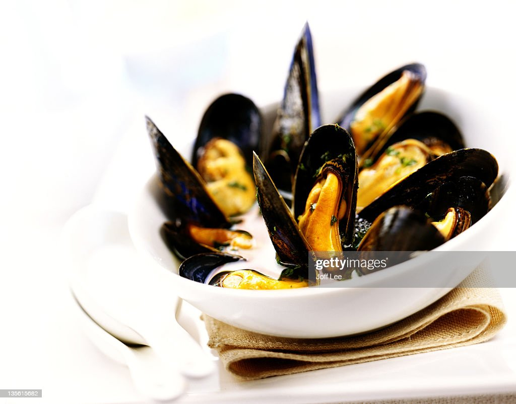 Moules mariniere in white bowl