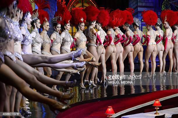 Moulin Rouge dancers perform on November 7 2014 in their bid to break the record of the most consecutive high kicks by a single chorus line in 30...