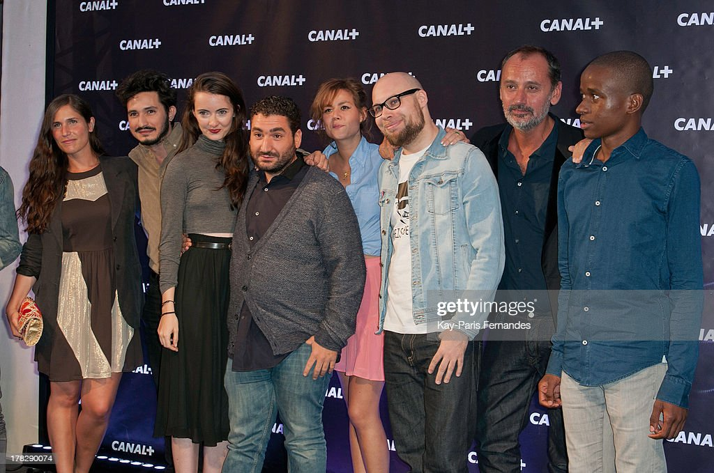 ÊMouloud Achour (c) and his co hosts from the show 'clique' at the 'Rentree De Canal +' photocall at Porte De Versailles on August 28, 2013 in Paris, France.