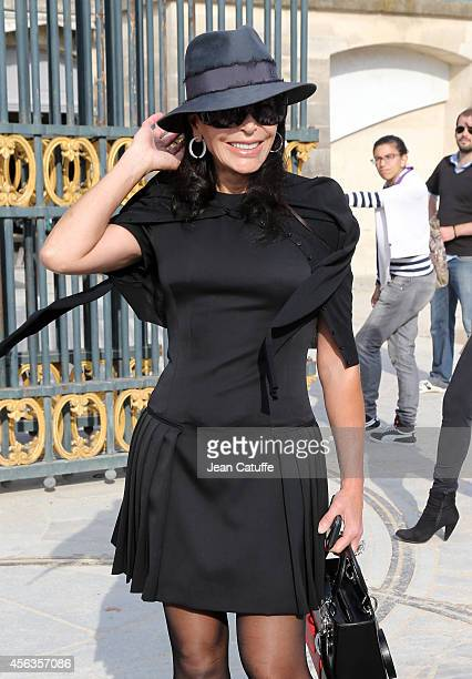 Mouna Ayoub attends the Elie Saab fashion show at the Jardin des Tuileries as part of the Paris Fashion Week Womenswear Spring/Summer 2015 on...