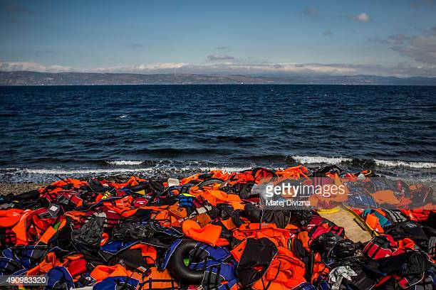 A mound of life jackets is seen on the shores of the Greek island of Lesbos on October 2 2015 near village of Skala Sikaminias Greece Despite bad...