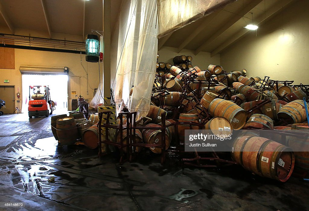 A mound of toppled wine barrels sit in a storage room at Kieu Hoang Winery on August 25, 2014 in Napa, California. A day after a 6.0 earthquake rocked the Napa Valley, residents and wineries are continuing clean up operations.