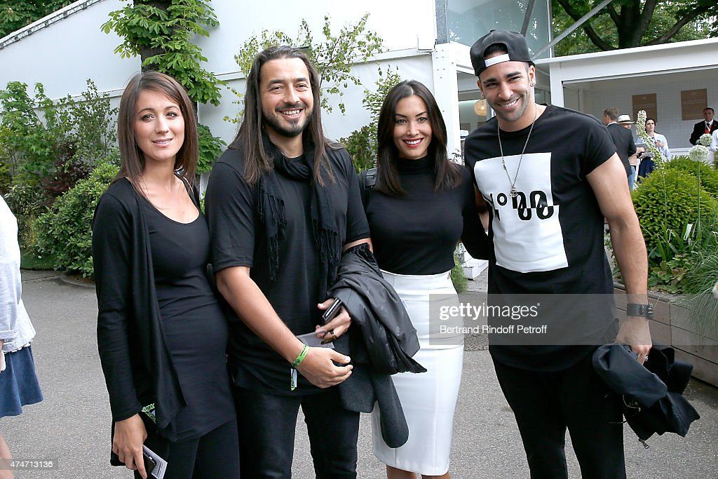 Moundir, his wife Ines, Milan AC French Football player <a gi-track='captionPersonalityLinkClicked' href=/galleries/search?phrase=Adil+Rami&family=editorial&specificpeople=4305019 ng-click='$event.stopPropagation()'>Adil Rami</a> and his companion Sidonie attend the 2015 Roland Garros French Tennis Open - Day 2, on May 25, 2015 in Paris, France.